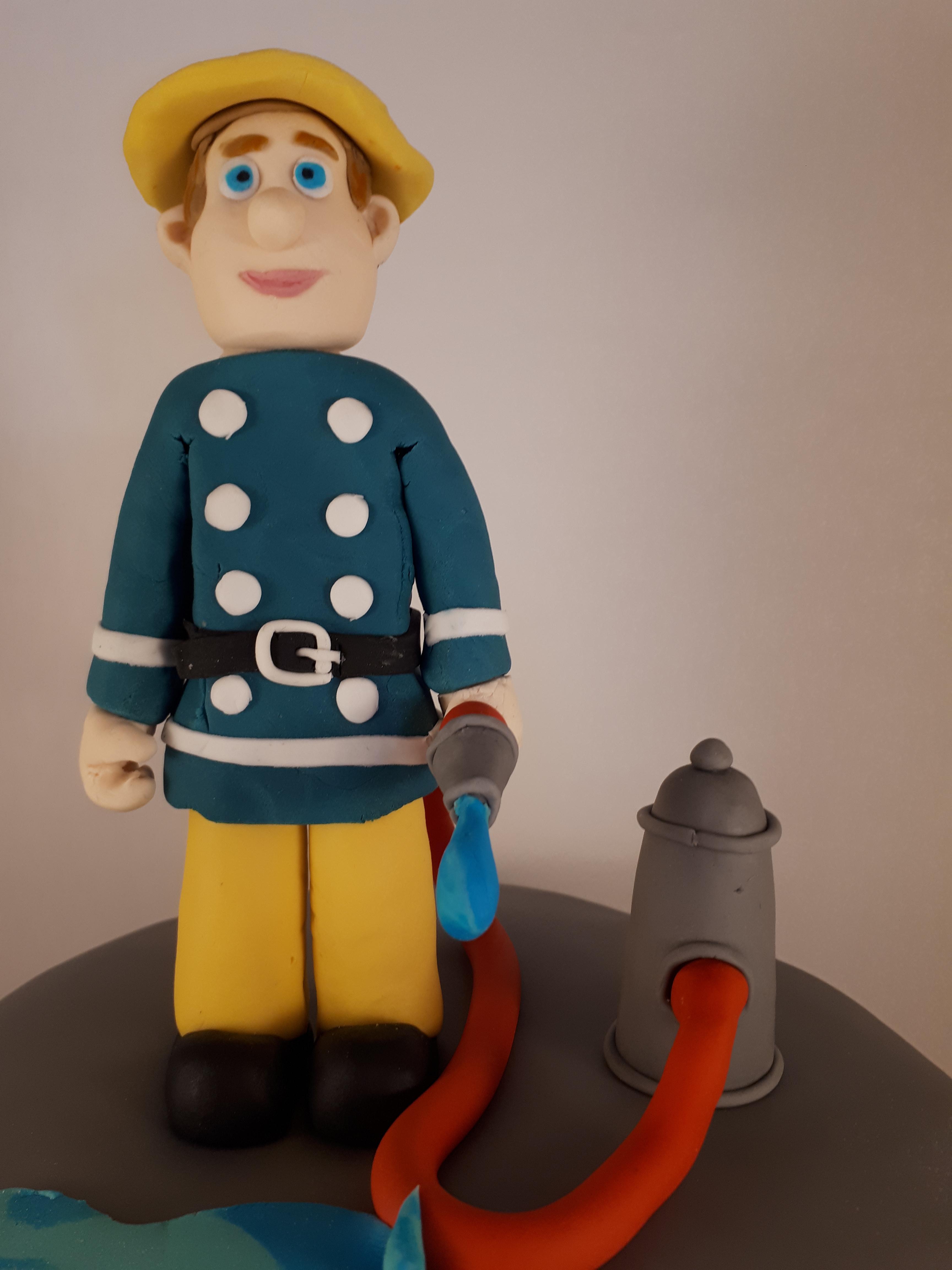 Brandweerman met slang