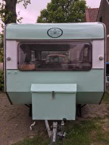 Het logo van Cakes on wheels.