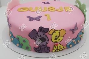 Woezel & Pip taart in lichte tinten met gouden accenten.