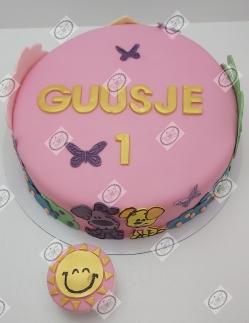 Woezel & Pip taart en cupcake in lichte tinten met gouden accenten.